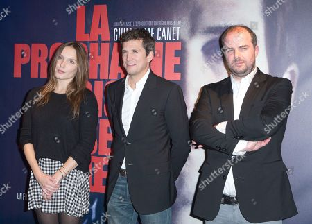 """Stock Picture of French actress Ana Girardot and actor Guillaume Canet, center, with film director Cedric Anger, right, pose for photographers during a photocall for his latest movie """"The next time I will aim at the heart"""" """"La prochaine fois je viserai le coeur"""" in Paris, France"""