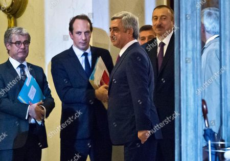 Serge Sarkisian, Ilham Aliyev Armenian President Serge Sarkisian, second right, and Azerbaijan's President Ilham Aliyev right, stand in the lobby after a meeting at the Elysee Palace in Paris, France, . French President Francois Hollande is holding a joint meeting in Paris Monday with the leaders of Azerbaijan and Armenia in an attempt to ease tensions, following the escalation of violence in the disputed Nagorno-Karabakh region of the southern Caucasus