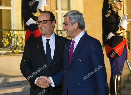 Francois Hollande, Serge Sarkisian France's President Francois Hollande, left, welcomes Armenian President Serge Sarkisian at the Elysee Palace in Paris, France, . French President Francois Hollande is holding a joint meeting in Paris Monday with the leaders of Azerbaijan and Armenia in an attempt to ease tensions, following the escalation of violence in the disputed Nagorno-Karabakh region of the southern Caucasus