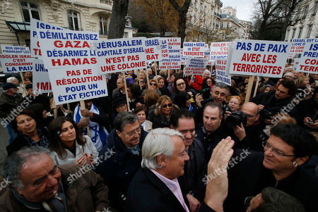 Claude Goasguen A member of the French Parliament Claude Goasguen, centre, waves as he arrives at a pro Israeli demonstration, after a debate on the recognition of the Palestinian at the French parliament in Paris, . France's government is pushing to revive Israeli-Palestinian peace talks, amid growing pressure across Europe for recognition of a Palestinian state after decades of Mideast stalemate. Placards read, at left, 'Demilitarize Gaza, disarm the Hamas', and 'No resolution for a fiction', 'Jerusalem capital of Israel is not a colony', 2nd left, and 'No peace with terrorists