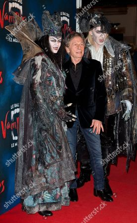 """Director Roman Polanski, center, poses with actors dressed as vampires at the premiere of """"The Fearless Vampire Killers"""", in Paris. Nearly 50 years after Roman Polanski directed the comedy-horror film ''The Fearless Vampire Killers,'' he is directing a musical version for the Paris stage. The 81-year-old hopes the popularity of the movie, which he and his future wife Sharon Tate starred in, will help make the musical a hit and boost Paris' dreary theater scene"""