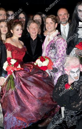 """Director Roman Polanski, center, poses with Actress Rafaelle Cohen, playing Sarah, left, and Daniele Carta Mantiglia playing Alfred, right, at the end of premiere of """"The Fearless Vampire Killers"""", in Paris. Nearly 50 years after Roman Polanski directed the comedy-horror film ''The Fearless Vampire Killers,'' he is directing a musical version for the Paris stage. The 81-year-old hopes the popularity of the movie, which he and his future wife Sharon Tate starred in, will help make the musical a hit and boost Paris' dreary theater scene"""