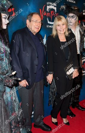"""Director Robert Hossein and Candice Patou pose with actors dressed as vampires at the premiere of """"The Fearless Vampire Killers"""", in Paris. Nearly 50 years after Roman Polanski directed the comedy-horror film ''The Fearless Vampire Killers,'' he is directing a musical version for the Paris stage. The 81-year-old hopes the popularity of the movie, which he and his future wife Sharon Tate starred in, will help make the musical a hit and boost Paris' dreary theater scene"""