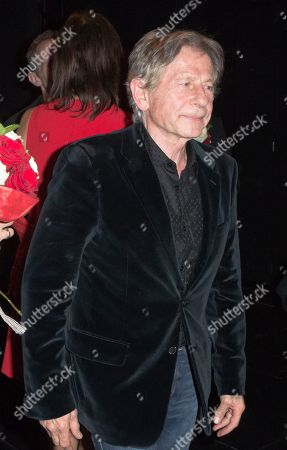 """Director Roman Polanski, center, walks on stage at the end of the premiere of """"The Fearless Vampire Killers"""", in Paris. Nearly 50 years after Roman Polanski directed the comedy-horror film ''The Fearless Vampire Killers,'' he is directing a musical version for the Paris stage. The 81-year-old hopes the popularity of the movie, which he and his future wife Sharon Tate starred in, will help make the musical a hit and boost Paris' dreary theater scene"""