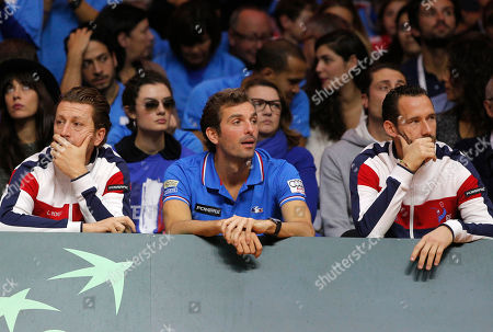 From the left, French coach Lionel Roux, player Julien Benneteau and trainer Michael Llodra watch Switzerland's Roger Federer playing France's Richard Gasquet during the Davis Cup final match in Lille, northern France, Sunday, Nov.23, 2014