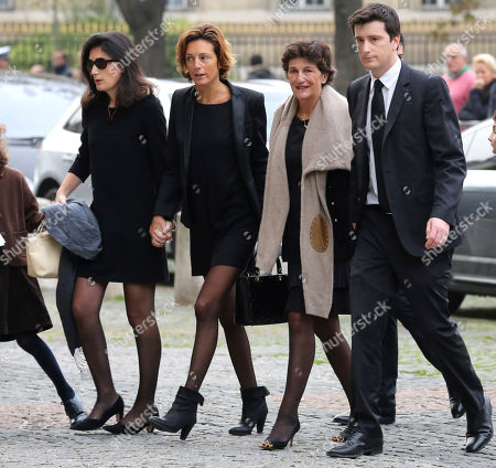 Bernadette de Margerie, second right, widow of former Total SA Chief Executive Christophe de Margerie, and relatives arrive at a funeral service for her husband at Saint Sulpice church in Paris, France, . Margerie and three French crew members were killed Oct. 20, when the business jet they were in clipped an airport snowplow on takeoff at Moscow's Vnukovo airport, crashed and burst into flames