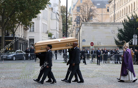 Pallbearers carry the coffin of former Total SA Chief Executive Christophe de Margerie before a funeral service at Saint Sulpice church in Paris, France, . Margerie and three French crew members were killed Oct. 20, when the business jet they were in clipped an airport snowplow on takeoff at Moscow's Vnukovo airport, crashed and burst into flames