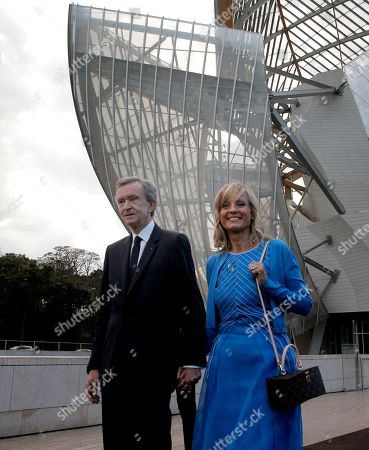 LVMH luxury group CEO Bernard Arnault and his wife Helene Mercier Arnault arrive for the inauguration of the Louis Vuitton Foundation art museum and cultural center in Paris, . The 100-million-euro building, with billowing glass casing and 11 gallery spaces, has been compared to an iceberg or giant sailboat and took over a decade to make