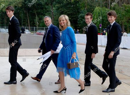 Helene Mercier Arnault, center, arrives at the inauguration of architect Frank Gehry's latest creation, the Louis Vuitton Foundation art museum and cultural center in Paris, . The 100-million-euro building, with billowing glass casing and 11 gallery spaces, has been compared to an iceberg or giant sailboat and took over a decade to make
