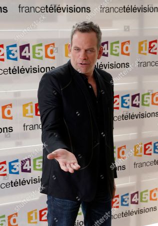 Canadian's singer Garou poses during a photocall before the presentation of the 2014 Telethon medical charity event, in Paris