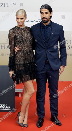 Sami Khedira, player of the German national soccer team, and his wife Lena Gerke pose for the media as they arrive for the premiere of the movie 'Die Mannschaft' (The Team) in Berlin, Germany