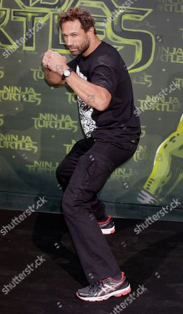 US musician Jared Hasselhoff poses for the photographers as he arrives for the screening of the movie 'Teenage Mutant Ninja Turtles' in Berlin, Germany