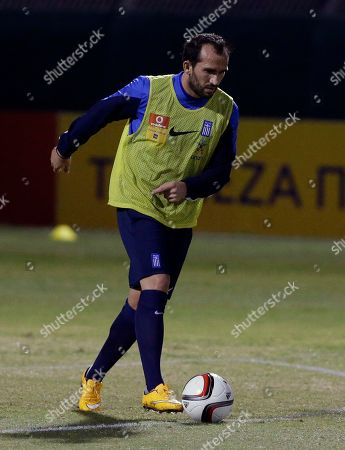 Fanis Gekas Greece's Fanis Gekas controls the ball during a training session in Athens on . Still looking for his first win as Greece coach, Claudio Ranieri has dropped Kostas Mitroglou for a European Championship home qualifier against the Faeroe Islands next Friday and a friendly against Serbia four days later. The surprise announcement came days after Georgios Samaras was also omitted, while Turkey-based veteran Fanis Gekas was recalled for duty at Karaiskaki Stadium