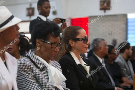 "Veronique Roy Veronique Roy, the former partner of Haiti's late dictator Jean-Claude ""Baby Doc"" Duvalier, center, attends Duvalier's funeral ceremony in Port-au-Prince, Haiti, . Many had wondered whether the self-proclaimed ""president for life"" would receive a state funeral following his death last Saturday from a heart attack at age 63. However, friends and family held a simple and private funeral"