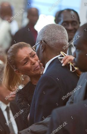 """Michele Bennett Michele Bennett, ex-wife of Haiti's late Dictator Jean-Claude """"Baby Doc"""" Duvalier, cries as she greets a man during Duvalier's funeral ceremony in Port-au-Prince, Haiti, . Many had wondered whether the self-proclaimed """"president for life"""" would receive a state funeral following his death last Saturday from a heart attack at age 63. However, friends and family held a simple and private funeral"""