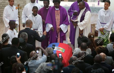 "Francois-Nicolas Duvalier Francois-Nicolas Duvalier, the son of Haiti's late dictator Jean-Claude ""Baby Doc"" Duvalier, sprinkles blessed water on the coffin of his father in Port-au-Prince, Haiti, . Many had wondered whether the self-proclaimed ""president for life"" would receive a state funeral following his death last Saturday from a heart attack at age 63. However, friends and family held a simple and private funeral"