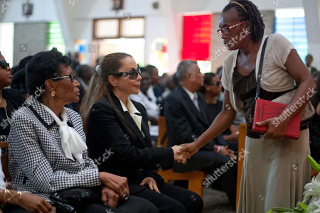 "Veronique Roy Veronique Roy, former partner of Haiti's late Dictator Jean-Claude ""Baby Doc"" Duvalier, center, shakes a women's hand during Duvalier's funeral ceremony in Port-au-Prince, Haiti, . Many had wondered whether the self-proclaimed ""president for life"" would receive a state funeral following his death last Saturday from a heart attack at age 63. However, friends and family held a simple and private funeral"