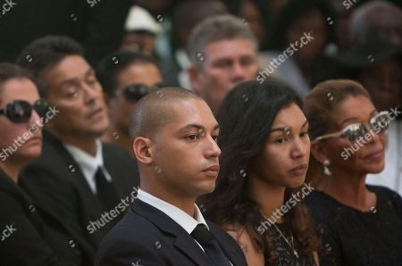 "Francois-Nicolas Duvalier, Anya Duvalier, Michele Bennett Family members of Haiti's late dictator Jean-Claude ""Baby Doc"" Duvalier, from left, son Francois-Nicolas, daughter Anya, and ex-wife Michele Bennett, attend Duvalier's funeral ceremony in Port-au-Prince, Haiti, . Many had wondered whether the self-proclaimed ""president for life"" would receive a state funeral following his death last Saturday from a heart attack at age 63. However, friends and family held a simple and private funeral"
