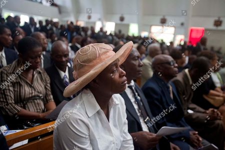 """A woman cries during the funeral ceremony for Haiti's late Dictator Jean-Claude """"Baby Doc"""" Duvalier in Port-au-Prince, Haiti, . Many had wondered whether the self-proclaimed """"president for life"""" would receive a state funeral following his death last Saturday from a heart attack at age 63. However, friends and family held a simple and private funeral"""