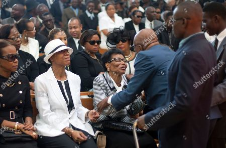 "Stock Photo of People attend the funeral ceremony for Haiti's late Dictator Jean-Claude ""Baby Doc"" Duvalier in Port-au-Prince, Haiti, . Many had wondered whether the self-proclaimed ""president for life"" would receive a state funeral following his death last Saturday from a heart attack at age 63. However, friends and family held a simple and private funeral"