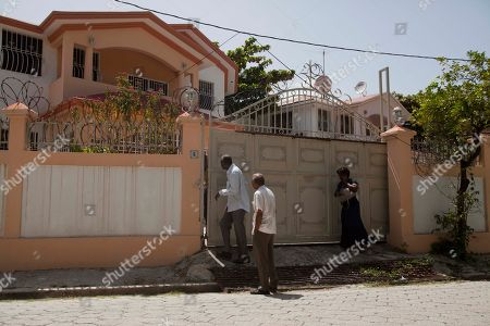 "People walk into the private residence where Former Haitian dictator Jean-Claude Duvalier, known as ""Baby Doc,"" died in Port-au-Prince, Haiti, . Duvalier, the self-proclaimed ""president for life"" of Haiti whose corrupt and brutal regime sparked a popular uprising that sent him into a 25-year exile, died Saturday of a heart attack, his attorney said"