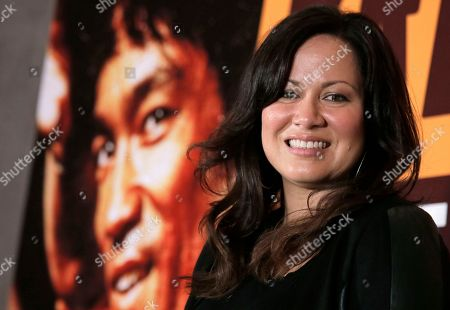 """Stock Photo of Shannon Lee Shannon Lee, daughter of Bruce Lee and president of the """"Bruce Lee Foundation,"""" poses for photographers during a press conference launching instant drinks in her father's name in Hong Kong"""