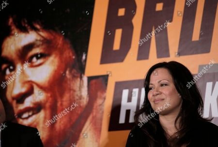 """Stock Image of Shannon Lee Shannon Lee, daughter of Bruce Lee and president of the """"Bruce Lee Foundation,"""" poses for photographers during a press conference launching instant drinks in her father's name in Hong Kong"""