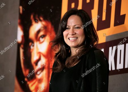 """Shannon Lee Shannon Lee, daughter of Bruce Lee and president of the """"Bruce Lee Foundation, poses for photographers during a press conference launching instant drinks in her father's name in Hong Kong"""