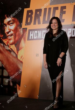 """Shannon Lee Shannon Lee, daughter of Bruce Lee and president of the """"Bruce Lee Foundation poses for photographers during a press conference launching instant drinks in her father's name in Hong Kong"""