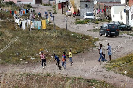 Footballing superstar Luis Nani, who has signed to Manchester United from Sporting Lisbon Kids Playing football on the streets yards away from  where Luis Nani grew up in the one bedroomed house in the slums of Lisbon she brought Luis Nani up in the after his mother and father left him in Lisbon