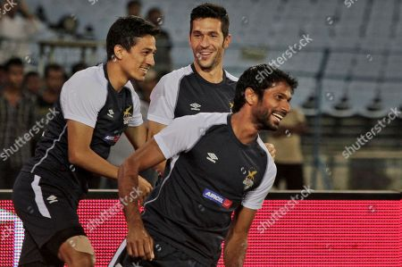 """Luis Garcia, Denzil Franco, Sanju Pradhan Spanish soccer star Luis Garcia, center, trains with teammates of the Atletico De Kolkata football club Denzil Franco, right, and Sanju Pradhan in Kolkata, India. The Indian Super League seems to have added the zing that football needed in this country of 1.2 billion people, which FIFA chief Sepp Blatter once called """"a sleeping giant."""" But while the new eight-team league featuring big names like Nicolas Anelka, Alessandro Del Piero, Robert Pires and Garcia has lifted the game to a level not seen here before, some football observers wonder whether it will be enough to help grow the sport in the long run"""