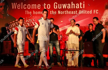 Stock Picture of Joan Capdevila Spain's Joan Capdevila, foreground, walks the ramp with other members of NorthEast United Football Club of Hero Indian Super League 2014 (ISL) during the launch of the team's jersey, in Gauhati, India, . ISL begins October. 12