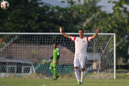 Stock Photo of Joan Capdevila Spanish footballer Joan Capdevila who plays for the NorthEast United club in the upcoming Indian Super League (ISL) gestures during a practice match in Gauhati, India, Thursday, Oct.9, 2014. The eight-team ISL, kicks off Oct. 12