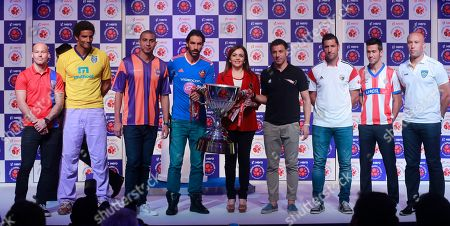 Indian Super League (ISL) founding chairperson Nita Ambani, center, poses with 'players from left, Swedish footballer Fredrik Ljungberg who will play for the Mumbai team, English footballer David James, who will play for the Kerala Blasters team, French footballer David Trezeguet, who will play for the Pune team, French footballer Robert Pires who will play for the Goa team, Italian footballer Alessandro Del Piero, who will play for the Delhi Dynamos team, Spanish footballer Joan Capdevila, who will play for the North East United team, Spanish footballer Luis García, who will play for the Atlético de Kolkata team and French footballer Mikaël Silvestre who will play for the Chennaiyin team during the unveiling of the ISL trophy in Mumbai, India, . The eight-team ISL kicks off on Oct.12