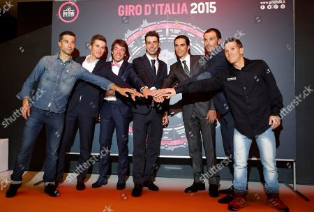 "From left: France's Nacer Bouhanni, reigning World Champion Poland's Michal Kwiatkowski, Colombia's Rigoberto Uran, Italy's Fabio Aru, Spain's Alberto Contador, Italy's Ivan Basso and Colombia's Julian Arredondo pose after the official presentation of the 2015 Giro d'Italia ""Tour of Italy"" cycling race, in Milan, Italy, . Giro d'Italia officials have unveiled a balanced route for next year's race, which they believe will allow cyclists to compete in the Tour de France as well as the Italian classic. The 2015 Giro will take the riders from San Remo to Milan, via central Italy, the Dolomites and the Alps over a total of 3,481.8 kilometers (2,163.6 miles) from May 9-31"