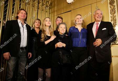 From left, German singer Klaus Florian Vogt (Florestan), British Opera director Deborah Warner, German Soprano Mojca Erdmann (Marzeline), German Tenor Florian Hoffmann (Jaquino), Costume designer Chloe Obolensky, German singer Anja Kampe (Leonore) and La Scala's general director Alexander Pereira at the end of a press conference at the La scala theater in Milan, Italy, . La Scala will open its season on Dec. 7 with Ludwig van Beethoven's Fidelio