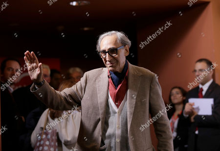 Franco Battiato waves to photographers during the photo call of the movie 'Due Volte Delta' at the 9th edition of the Rome International Film Festival in Rome