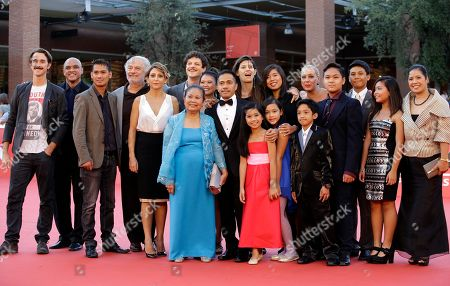 """Director Andrea Bosca, background center, poses for photographers with the movie cast on the red carpet for the screening of the movie """"A Tutto Tondo"""" at the Rome Film Festival, in Rome"""