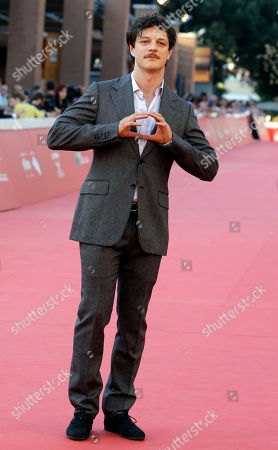 """Director Andrea Bosca poses for photographers on the red carpet for the screening of the movie """"A Tutto Tondo"""" at the Rome Film Festival, in Rome"""