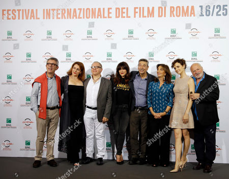 "Stock Image of From left, Actors Gianfelice Imparato, Daniela Giordano, Marco Messeri, Valentina Lodovini, Director and Actor Gianni Di Gregorio, actresses Daniela Giordano, Camilla Filippi and actor Marco Messeri pose for photographers during a photo call of the movie ""Buoni a Nulla"" at the Rome Film Festival, in Rome"