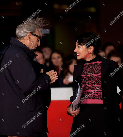 Musician Franco Battiato, left, and director Elisabetta Sgarbi pose for photographers during the red carpet of the movie 'Due Volte Delta' at the 9th edition of the Rome International Film Festival in Rome