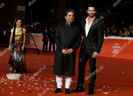Stock Picture of Actor Shahid Kapur, right, and director Vishal Bhardwaj pose for photographers on the red carpet on the occasion of the screening of the movie Haider during the 9th edition of the Rome Film Festival in Rome