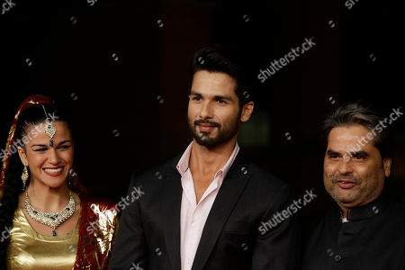 Stock Photo of Actor Shahid Kapur, center, and director Vishal Bhardwaj pose for the photographers on the red carpet on the occasion of the screening of the movie Haider during the 9th edition of the Rome Film Festival in Rome