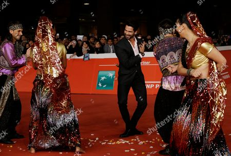 Actor Shahid Kapur, center, poses for photographers on the red carpet on the occasion of the screening of the movie Haider during the 9th edition of the Rome Film Festival in Rome