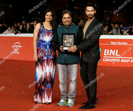 Director Vishal Bhardway, center, and actor Shahid Kapur, right, pose on the red carpet with Mondo Genere award during the 9th edition of the Rome Film Festival in Rome