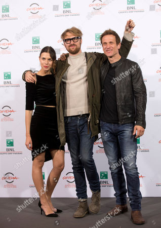 From left, actress Ana Ularu, director Lorenzo Sportiello, actor Simon Merrells, pose for photographers during the photo call of the movie 'Index Zero' at the 9th edition of the Rome International Film Festival in Rome