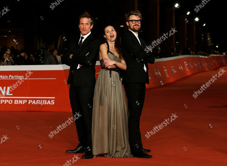 From left, Actors Simon Merrells, Ana Ularu and director Lorenzo Sportiello pose for the photographers on the red carpet on the occasion of the screening of the movie Index Zero during the 9th edition of the Rome Film Festival in Rome