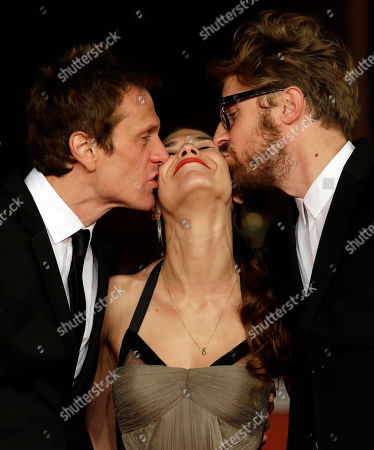 From left, Actors Simon Merrells, Ana Ularu and director Lorenzo Sportiello pose for photographers on the red carpet on the occasion of the screening of the movie Index Zero during the 9th edition of the Rome Film Festival in Rome