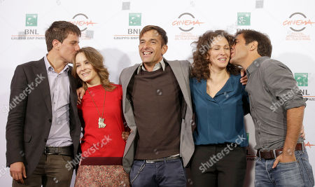 From left, actors Domenico Diele, Maria Roveran, director Claudio Noce, Ksenia Rappoport and Adriano Giannini, poses for photographers during the photo call of the movie 'La Foresta di Ghiaccio' at the 9th edition of the Rome International Film Festival in Rome
