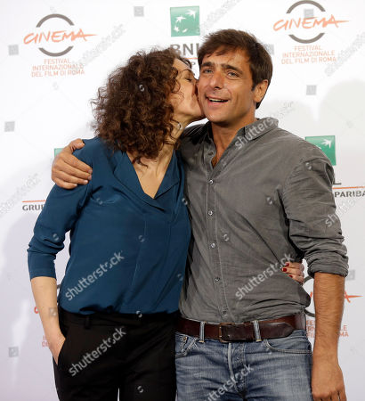Actor Adriano Giannini, right, and Ksenia Rappoport pose for photographers during the photo call of the movie 'La Foresta di Ghiaccio' at the 9th edition of the Rome International Film Festival in Rome